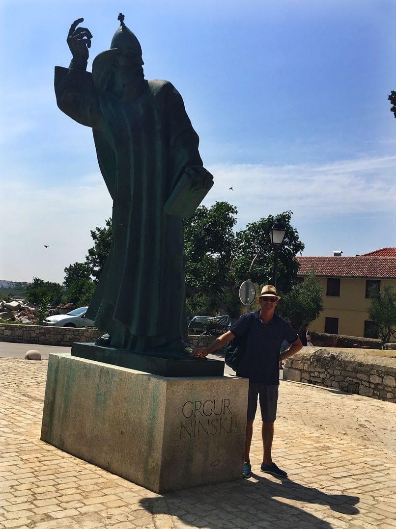 Ray rubbing the toe of the Grgur Ninski statue